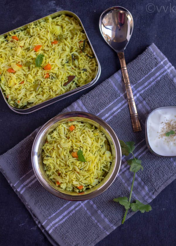 no onion no garlic pulav in a bowl and tiffin box