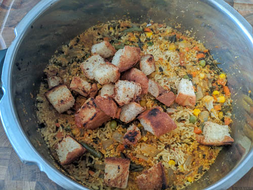 veg biryani adding bread