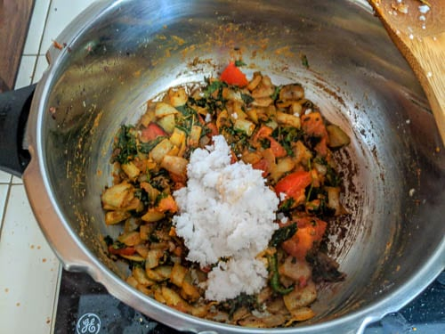 veg biryani adding coconut paste