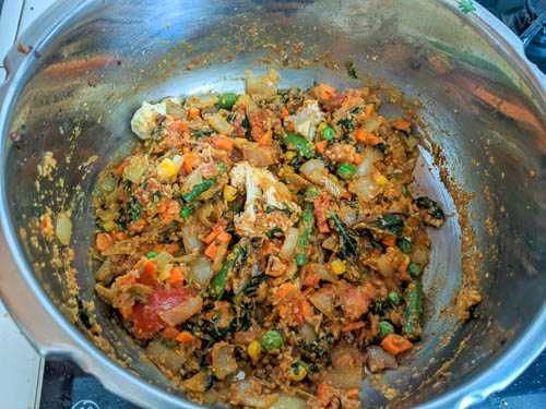 veg biryani adding vegetables