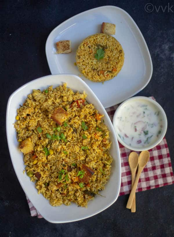 top angle of veg biryani with raita