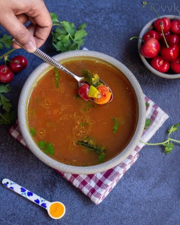 cherry rasam with cherries and garlic