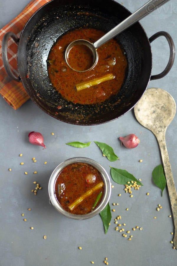 dhaniya kuzhambu in a kadai and bowl
