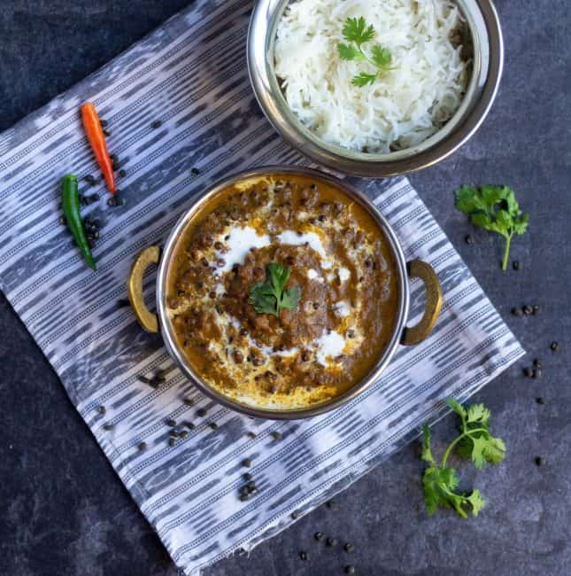 Instant pot kali dal in bowl with rice on the side