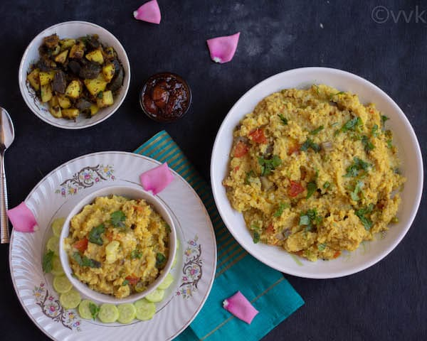 moong dal khichdi served with potato curry and cherry pickle