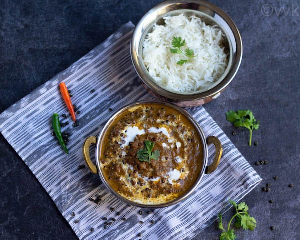 kali dal in a bowl with rice on side
