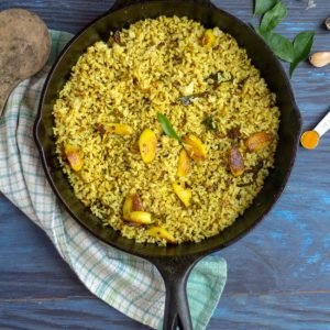 garlic rice in a cast iron pan