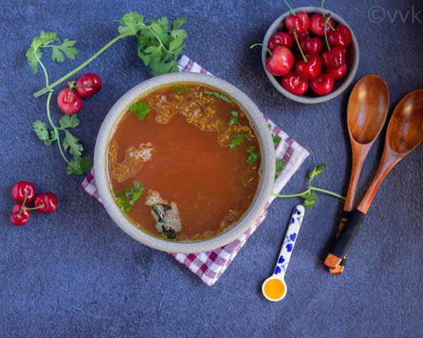 cherry rasam in white ceramic bowl
