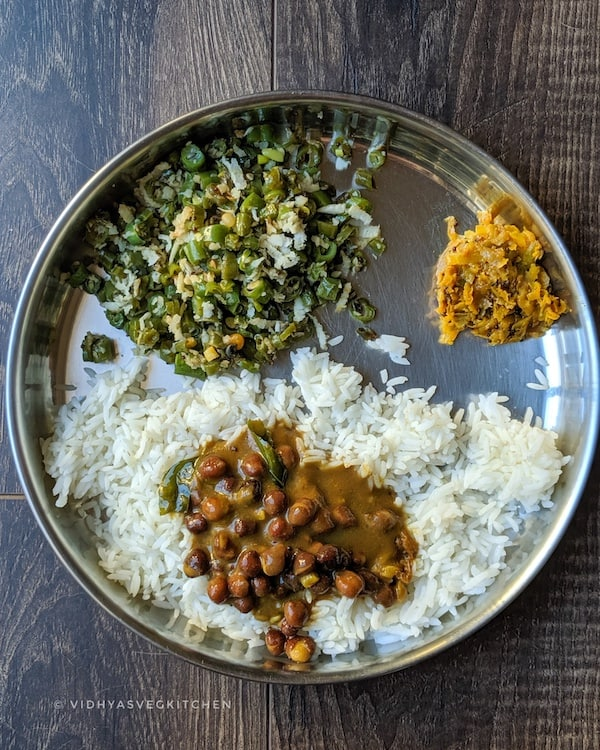 everyday cooking rice, beans curry, mango pickle and chickpeas kuzhambu