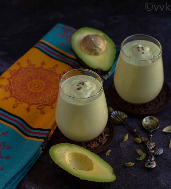breakfast smoothie with avocado in two glass jars