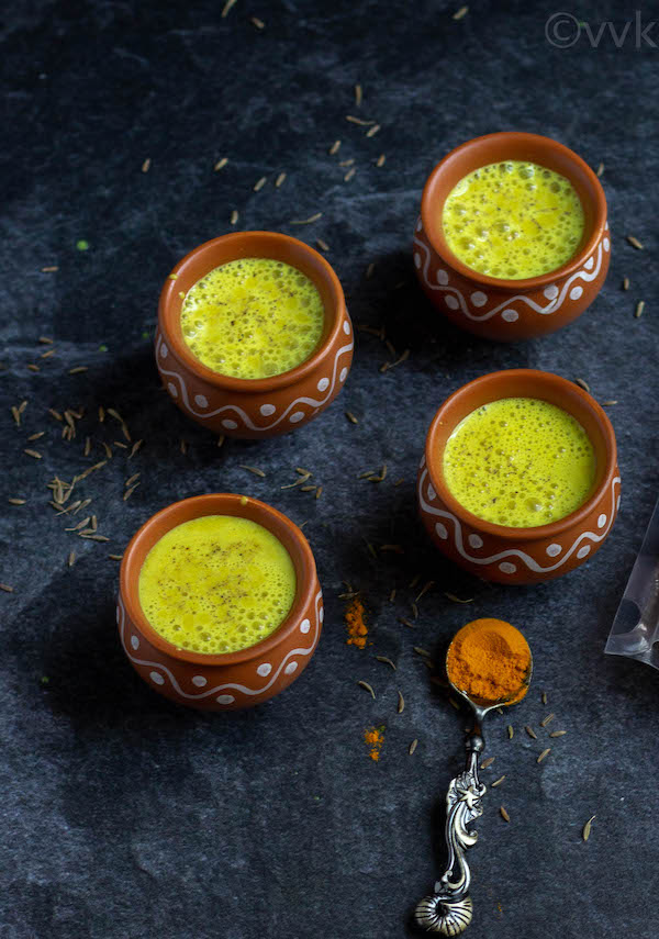 turmeric buttermilk in small earthen cups