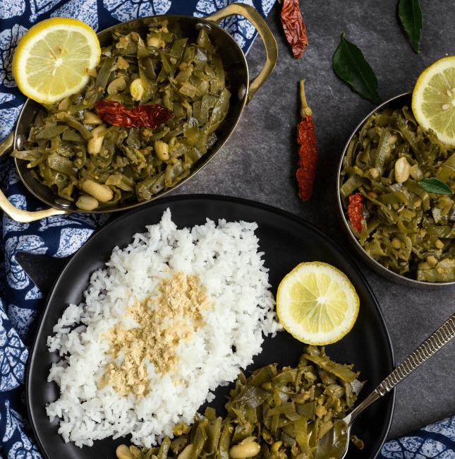 avarakkai poriyal with rice and a lemon slice