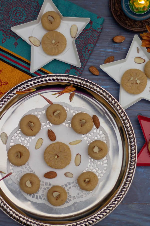 microwave badam peda in silver plate and star shaped plates