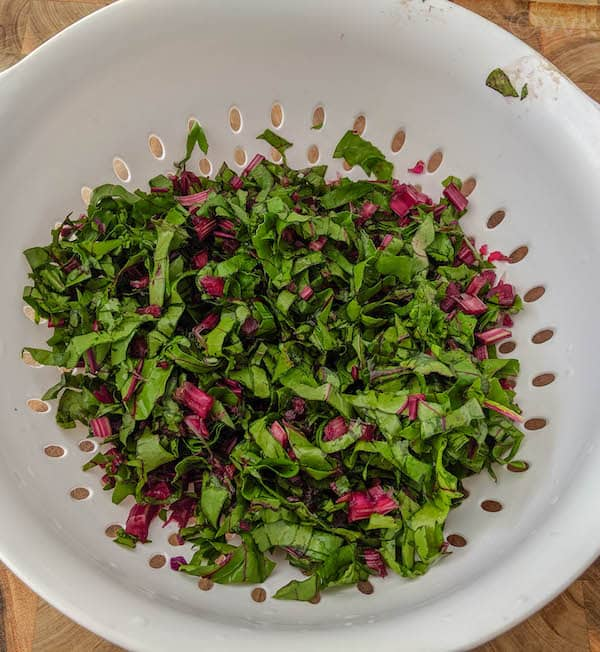 chopped beet greens in a colander