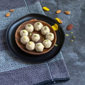 metta atta ladoo in a black and brown plate