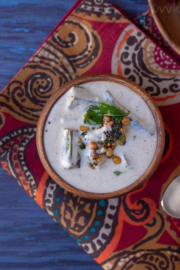 top angle of okra raita placed on a red mat