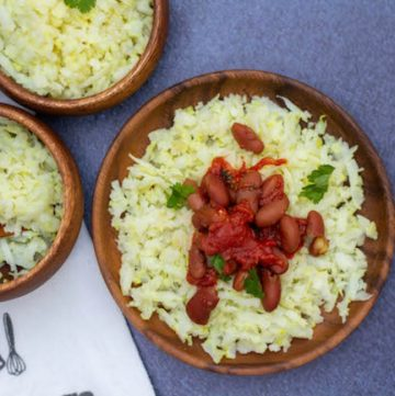 cauliflower rice with rajma curry on a wooden plate