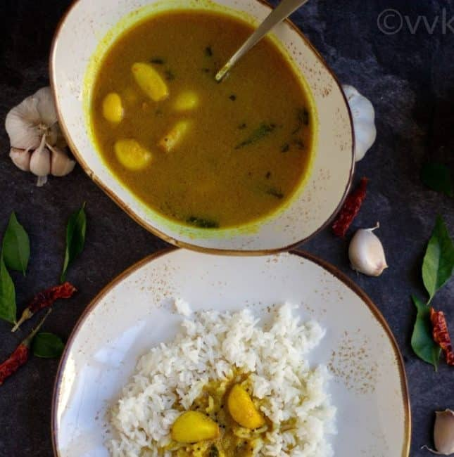 poondu kuzhambu in a white bowl and poondu kuzhambu with rice on a white plate