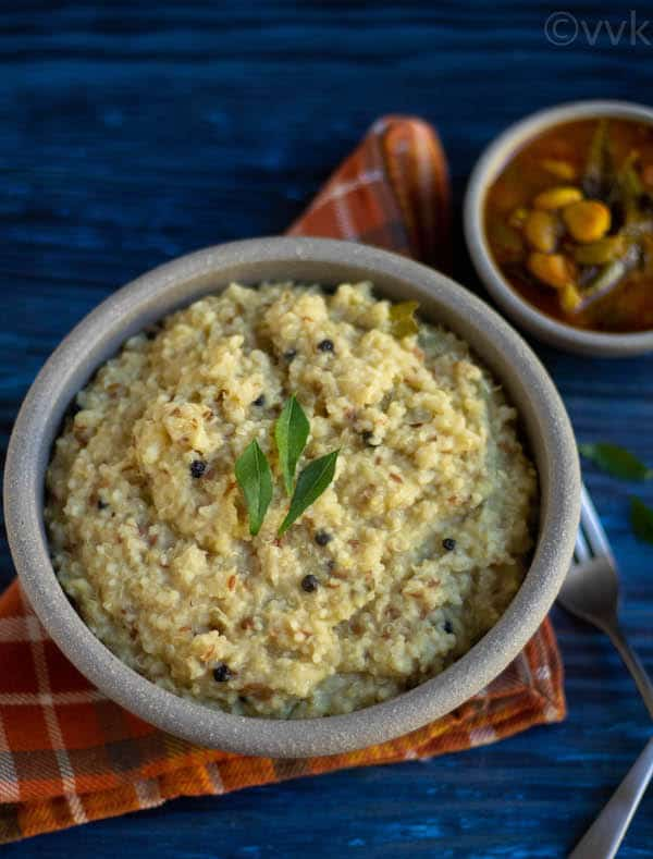 instant pot quinoa ven pongal in a white ceramic bowl