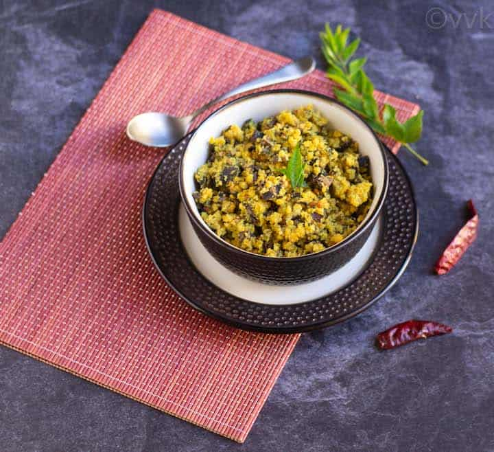 angled shot of vazhaipoo paruppu usili placed on a bowl on red mat