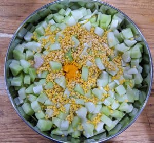 steaming chayote squash and moong dal for kootu