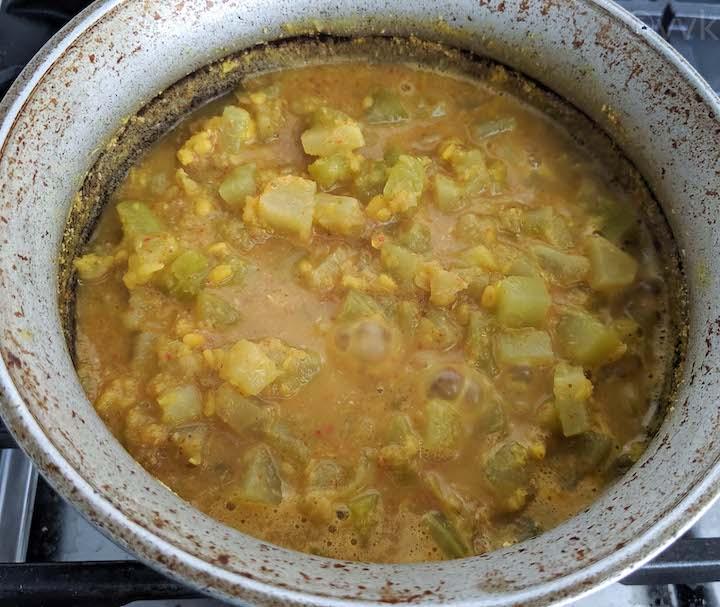 chow chow kootu simmering in a hindolium uruli