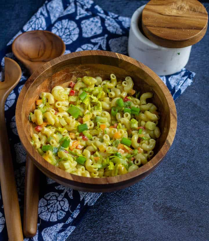 macaroni salad in a wooden bowl after mixing