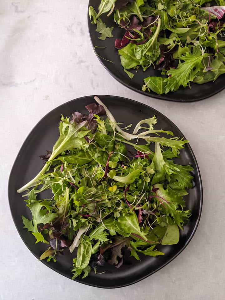 salad - first layer with mixed greens and microgreens