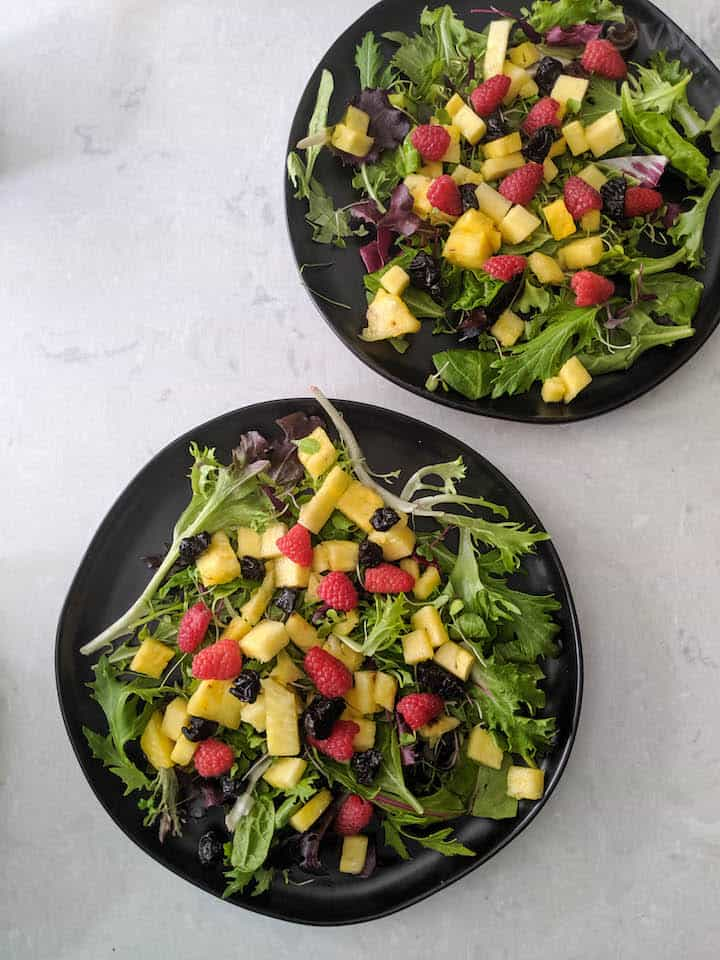 fully layered mixed greens and fruit salad with honey