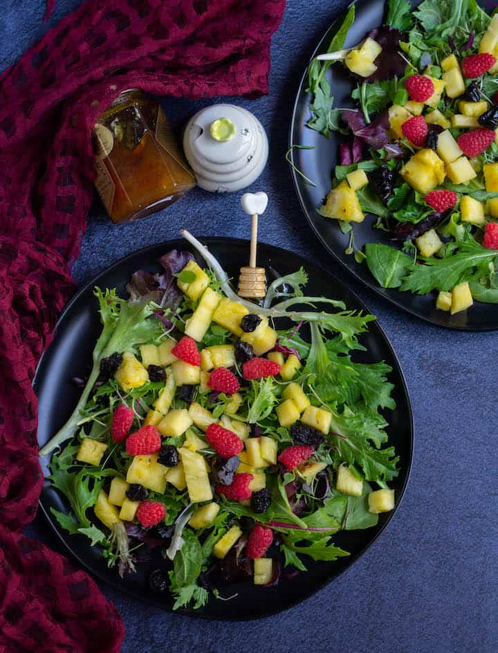 greens and fruits salad with honey