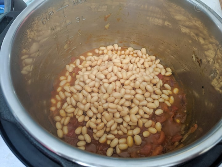 adding soaked soy beans