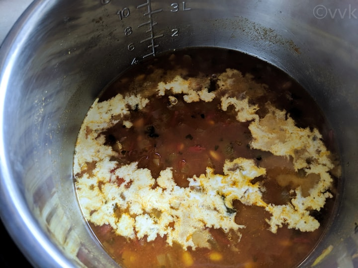 adding cream to soybean curry