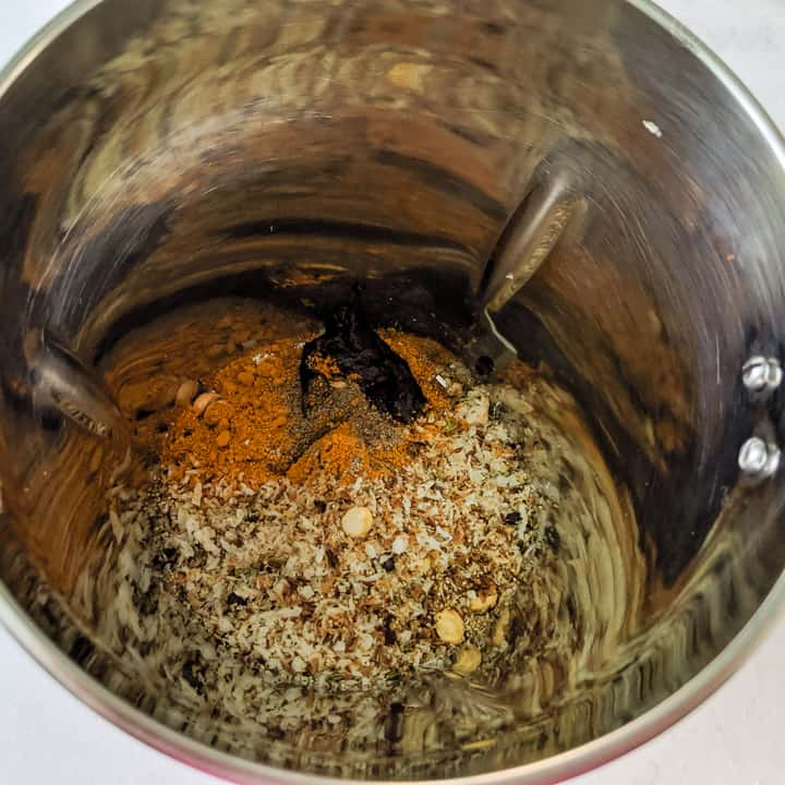 adding the roasted masala to the mixer jar