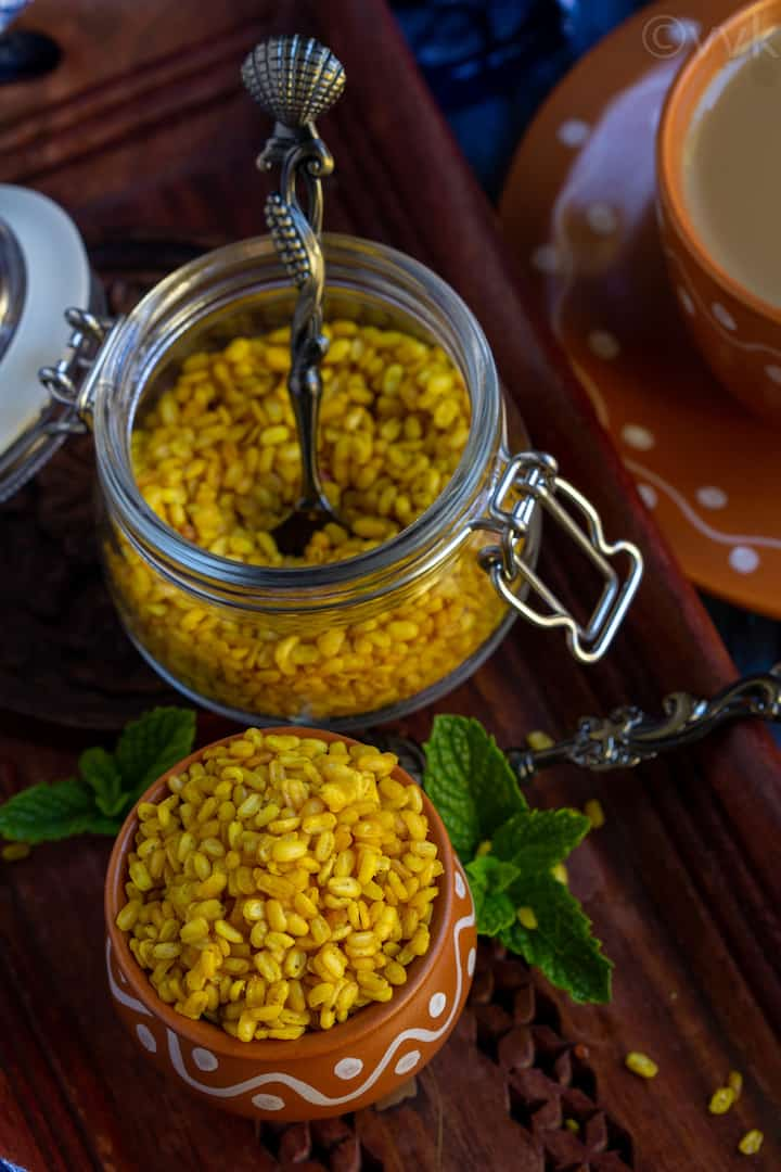 homemade moong dal namkeen placed in a small glass jar and kulhad cups