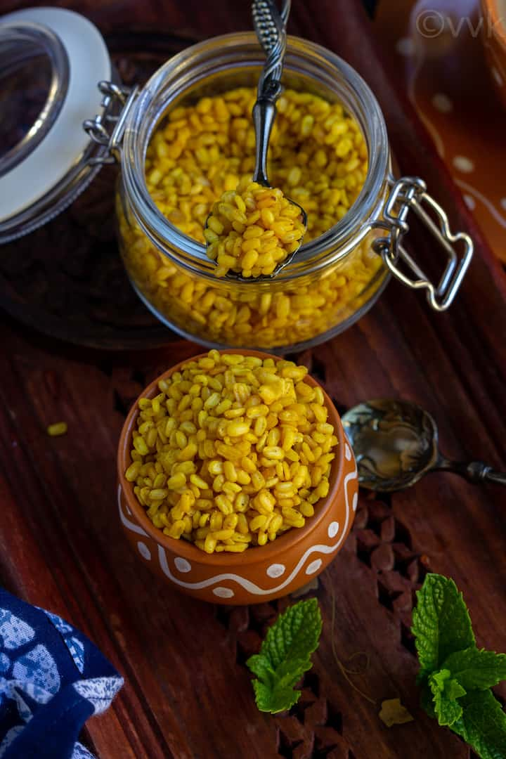 overhead shot of moong dal chaat in a kulhad cup and in a bottle
