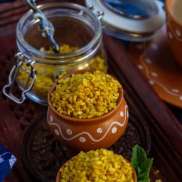 close of shot of moong dal chaat in a terracotta cup