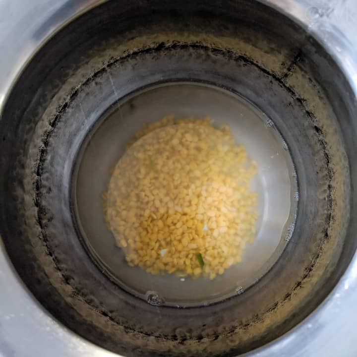 adding the moong dal and water first in the inner pot