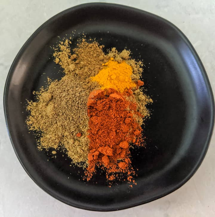 adding all the spices in a plate