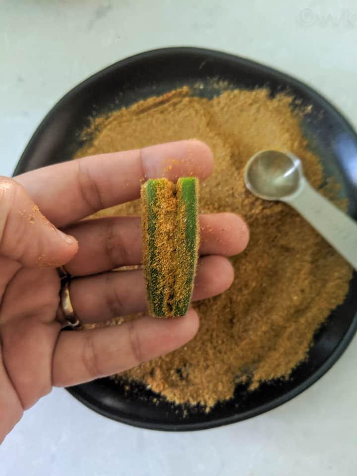 stuffing the bindi with the masala