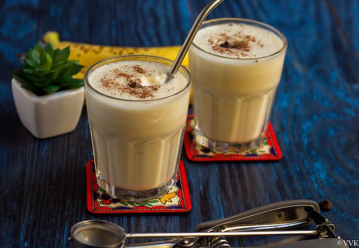 horizontal shot of banana milkshake with chocolate garnishing