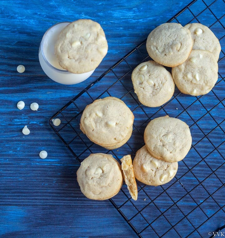 overhead shot of white cholate macadamia cookies on a cooling rack