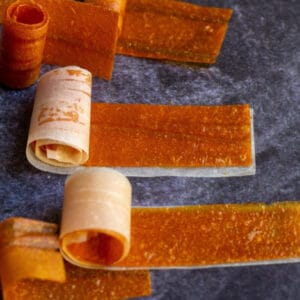 square image of mango roll ups with parchment paper
