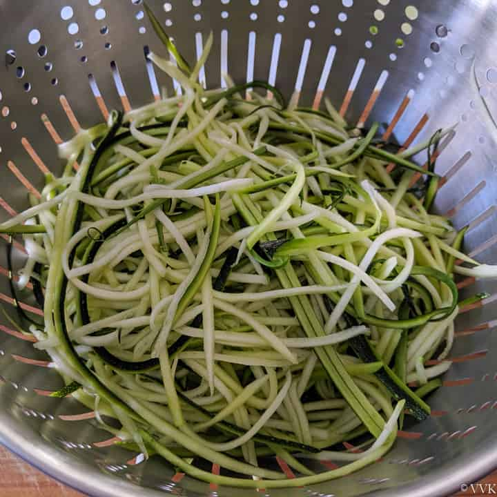 zucchini noodles peeled in a colander