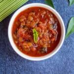 square image of tomato onion relish in a white bowl