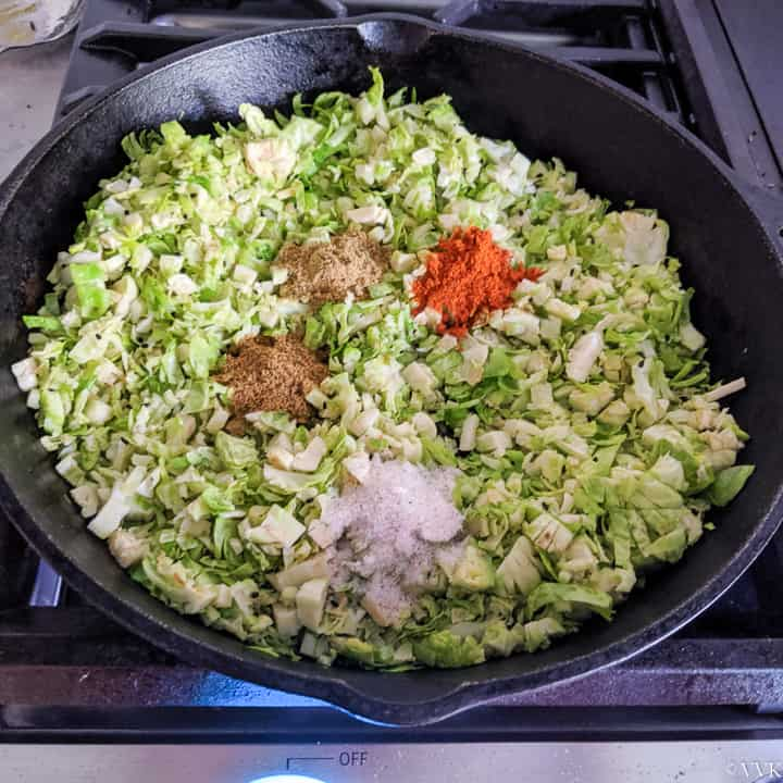 adding the spices to the brussels sprouts