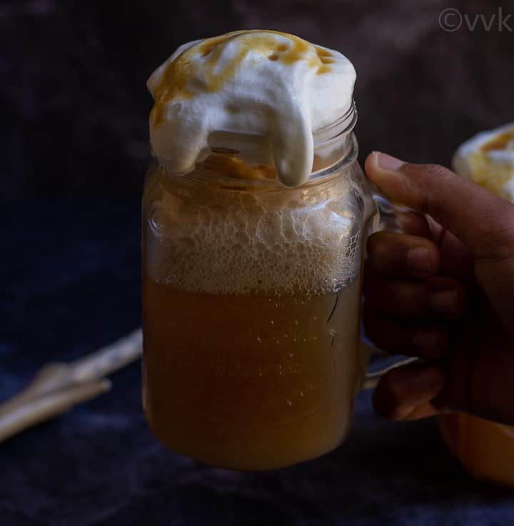 handholding shot of butterbeer in mason jar