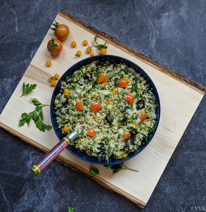 simple quinoa salad served in a blue bowl