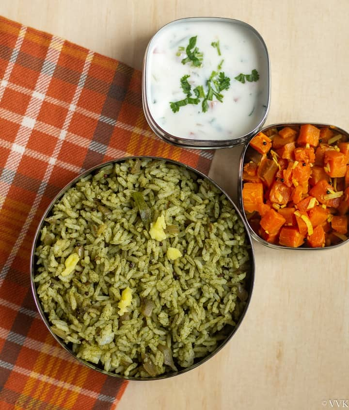 mint rice in lunch box with raita and carrot curry