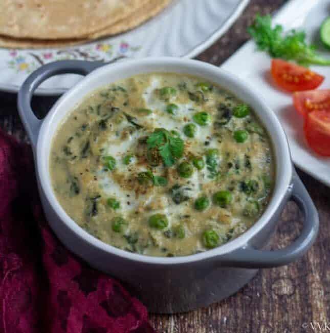 square image of methi matar malai in a gray casserole