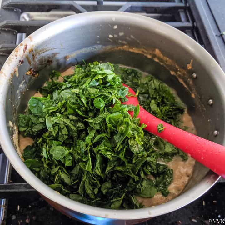 adding fenugreek to the methi matar malai curry